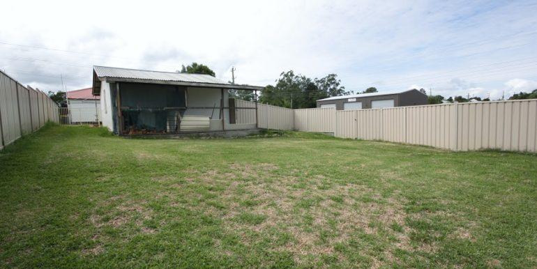 Back yard with carport